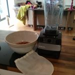 Equipment to make almond milk: blender, bowl of soaking almonds and a nut bag.